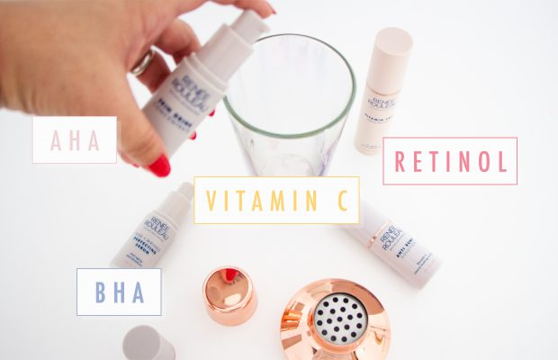 Hand mixing skincare ingredients into a glass