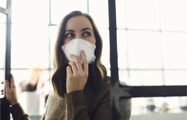 Woman wearing protective face mask in public