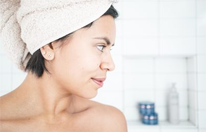 Woman in shower back and body acne