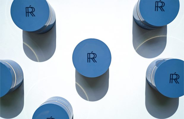 Blue jars of skincare product with Renée Rouleau logo