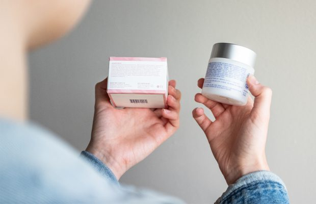 woman comparing two skincare ingredient labels